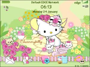 Charmmy Kitty in beautiful flower garden